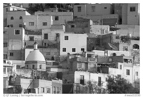 Multicolored houses on a steep hillside, late afternoon. Guanajuato, Mexico (black and white)