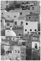 Houses painted with bright colors on a steep hillside. Guanajuato, Mexico (black and white)