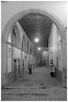 Man walking in an arched passage a dawn. Guanajuato, Mexico (black and white)