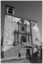 People walking in front of church San Roque, early morning. Guanajuato, Mexico ( black and white)