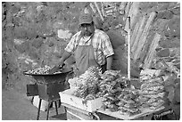 Man selling grilled peanuts on the street. Guanajuato, Mexico ( black and white)