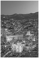 Panoramic view of the historic town with illuminated basilic, university, and La Compania. Guanajuato, Mexico (black and white)