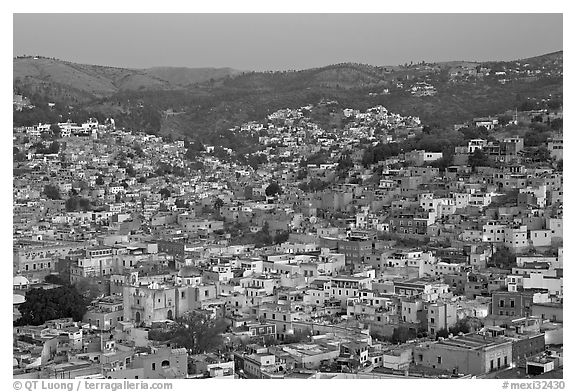 Panoramic view of the historic town and surrounding hills at dawn. Guanajuato, Mexico (black and white)