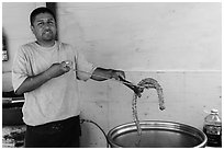 Man making churros. Baja California, Mexico ( black and white)