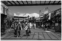 Musicians walking in flee market, La Bufadora. Baja California, Mexico ( black and white)