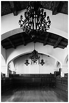 Ballroom and intricate ironwork in heavy chandeliers, Riviera Del Pacifico, Ensenada. Baja California, Mexico (black and white)