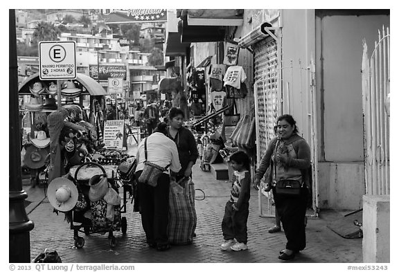 Women packing souvenirs for sale, Ensenada. Baja California, Mexico (black and white)