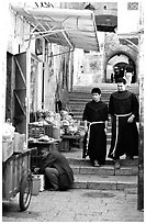 Two christian monks in a narrow alley. Jerusalem, Israel (black and white)