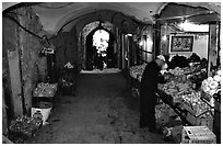 Fruit and vegetable store in an old town archway. Jerusalem, Israel (black and white)