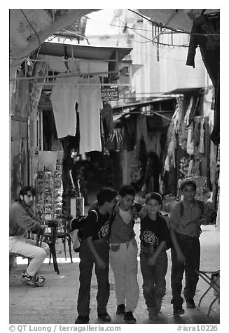 Children in a busy old town alley. Jerusalem, Israel (black and white)