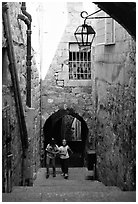 Children on stairs of an old alley. Jerusalem, Israel (black and white)