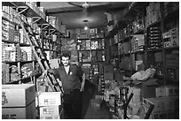 Man in a store, Hebron. West Bank, Occupied Territories (Israel) ( black and white)