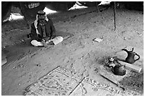 Bedouin man sitting on a carpet in a tent, Judean Desert. West Bank, Occupied Territories (Israel) ( black and white)