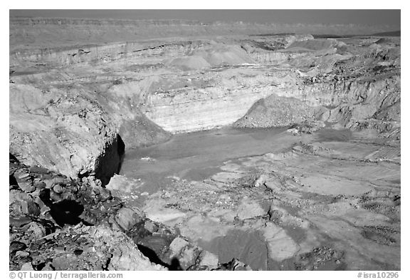 Shallow pond and colored rocks, near Mitzpe Ramon. Negev Desert, Israel (black and white)