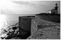 Seawall and lighthouse, late afternoon, Akko (Acre). Israel (black and white)