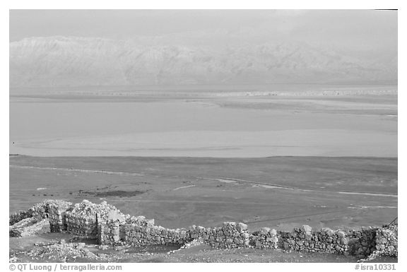 Ancient ruined walls of Masada and Dead Sea valley. Israel (black and white)
