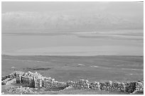 Ancient ruined walls of Masada and Dead Sea valley. Israel ( black and white)