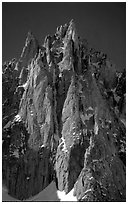 The Super-Couloir on Mt Blanc du Tacul is the very steep and narrow gully, Mont-Blanc Range, Alps, France. (black and white)