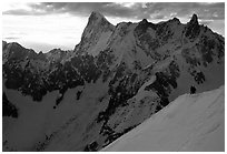 Alpinists go down Aiguille du Midi on a sharp ridge. Alps, France (black and white)