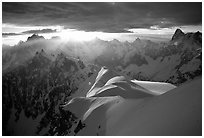 Aiguilles de Chamonix, Courtes-Verte ridge, and Grandes Jorasses seen from Aiguille du Midi. Alps, France (black and white)