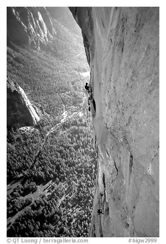 Valerio Folco at the belay, Tom McMillan cleaning the crux pitch. El Capitan, Yosemite, California