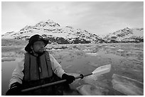 Kayaker on ice-chocked waters close to John Hopkins Inlet. Glacier Bay National Park, Alaska (black and white)