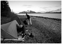 Kayakers getting into their tents for the night,  East Arm. Glacier Bay National Park, Alaska (black and white)