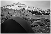 Park visitor looking, camp in front of Lamplugh Glacier. Glacier Bay National Park, Alaska (black and white)