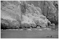 Kayaker bellow  the front of Lamplugh Glacier. Glacier Bay National Park, Alaska (black and white)