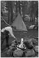 Woman preparing food at campfire, Le Conte Canyon. Kings Canyon National Park, California (black and white)