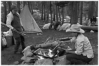 Women preparing food at camp, Le Conte Canyon. Kings Canyon National Park, California (black and white)