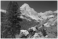 Man riding horse and Langille Peak, Le Conte Canyon. Kings Canyon National Park, California (black and white)