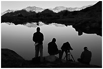 Film crew in action at lake, sunrise, Dusy Basin. Kings Canyon National Park, California (black and white)