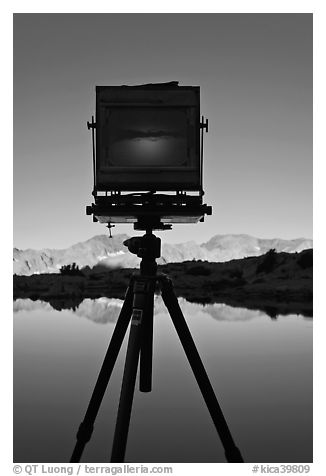 Large format camera with inverted image of mountain landscape on ground glass dusy basin