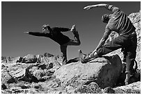 Hikers doing stretching exercises, Bishop Pass. Kings Canyon National Park, California (black and white)