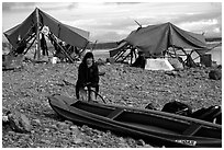 Inflating the canoe next to an Eskimo fish camp in Ambler. Kobuk Valley National Park, Alaska (black and white)