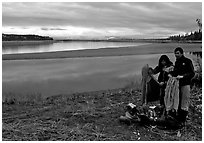 Canoeist drying out clothing over a campfire. Kobuk Valley National Park, Alaska (black and white)