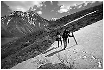 Backpackers crossing a neve. Lake Clark National Park, Alaska (black and white)