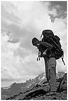 Woman backpacker with a large backpack. Lake Clark National Park, Alaska (black and white)