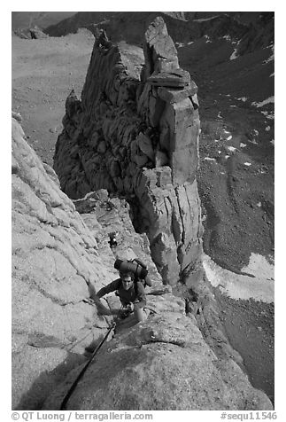 Man climbing East face of Mt Whitney. Sequoia National Park, California