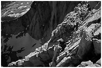 Mountaineer among broken rocks in the East face of Mt Whitney. Sequoia National Park, California (black and white)