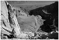 Man pausing on steep terrain in the East face of Mt Whitney. Sequoia National Park, California (black and white)