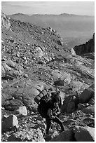 Mountaineers hiking on approach to  East face of Mt Whitney. Sequoia National Park, California (black and white)