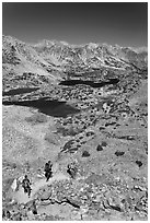 Hikers on trail above Saddlebag Lakes, John Muir Wilderness. Kings Canyon National Park, California (black and white)