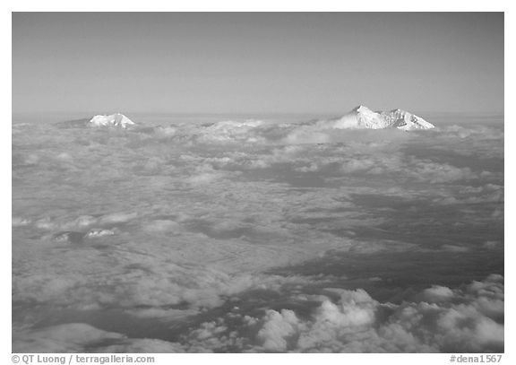 Summit of Mt Foraker and Mt Mc Kinley emerging from  clouds. Denali National Park, Alaska, USA.