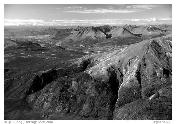 Aerial view of mountains with meandering Alatna river in the distance. Gates of the Arctic National Park (black and white)