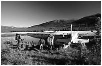 Backpackers beeing picked up by a floatplane at Circle Lake. Gates of the Arctic National Park, Alaska (black and white)