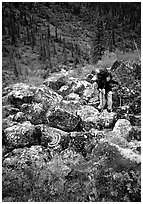 Backpacker on boulder field in Arrigetch Creek. Gates of the Arctic National Park, Alaska (black and white)
