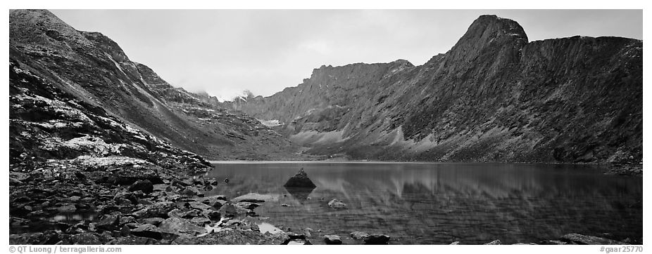 Mineral landscape with scree, rocky peaks, and lake. Gates of the Arctic National Park (black and white)