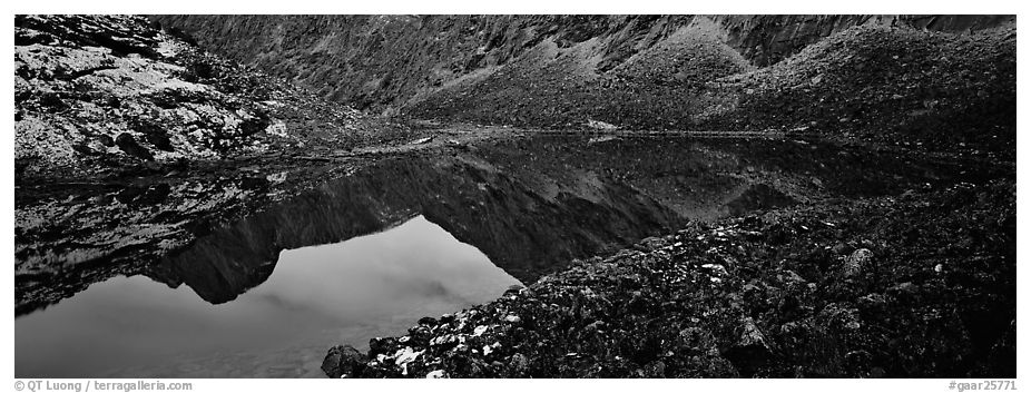 Mountain lake with reflections in rocky environment. Gates of the Arctic National Park (black and white)